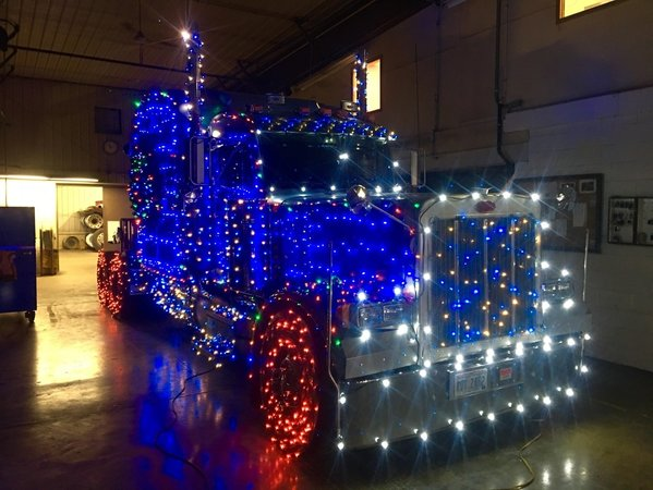 blue and white mini leds mixed with multi colored lights on a semi truck